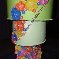 Flowery Upside Down Cake   Buttercream with Fondant flowers.