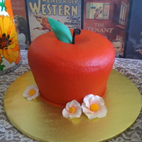 Apple Cake A three layer spice pound cake. Iced in buttercream, leaf and stem are fondant, flowers are gumpaste.