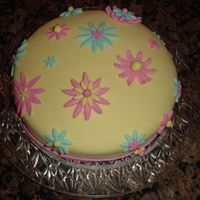 Girly Cake   This is my very 1st MMF Cake.Yellow MMF cake with cookie cutter pink yellow and blue flowers.