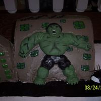 Incredible Hulk Hulk is made out of fondant. I molded him piece by piece and then added the details by accentuating with a brush and food coloring. Bldg is...