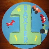Boy's First Birthday Choc mud covered in fondant with fondant cut outs