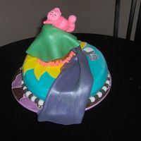 Alice In Wonderland - The Cheshire Cat This is my second cake. I wanted to try something colorful and whimsical, so I thought I would do a take on Alice in Wonderland.This is my...