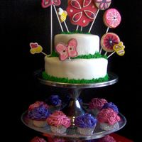 Flower Blossoms Birthday Cake This was for my niece's 6th birthday. I have another photo that includes a little girl doing a karate kick, the only stipulation she...