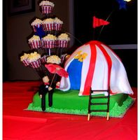 Circus Themed Cake This cake was for the opening night of the local prep school's play, JB. Based on the story of Job, this play takes place in a circus...