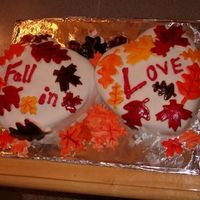 Fall In Love... I made this cake for my mom's fall wedding. Two heart-shaped cake pans with fondant leaves scattered over it.