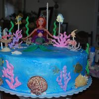 Little Mermaid Cake this is home made buttercream frosting spray painted blue .. I used real sea shells bought at the store and some scrapbooking stickers..see...