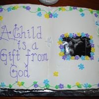 A Child Is A Blessing From God  My friend wanted a religious type cake for her baby shower so I made this using the book cake pan from Wilton. Home made buttercream recipe...