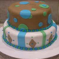 2 Tier Geometric Shapes done for my nephews 1st bday. all fondant accent w/ buttercream border.