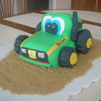 John Deere Tractor 2 another tractor cake for a little 2yr old boy. all fondant with doughnut wheels
