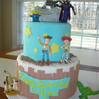 Toy Story 3 tier fondant accents and plastic figures
