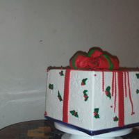 Christmas Cake christmas cake.3 layer 10 inch chocolate cake.Butter cream with fondant bows.TFL