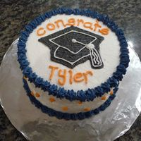 High School Grad Gift All buttercream icing. 2 layers. 6 inch cake for graduating neighbor boy to eat all himself! Blue and orange are school colors