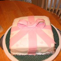 Package Cake From Course 3 pink bow cake with soft pink flowers
