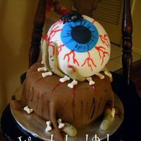 Dscf8950.jpg This is another one done for a friend. He wanted it gorey. This was the first time I ever used a round pan. Covering with fondant was quite...