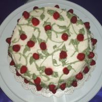 Cake With Raspbery Filling And Fresh Raspberries  This is a red velvet cake with raspberry filling and fresh raspberries dipped in red crushed cake sprinkles on top. It has cream cheese...