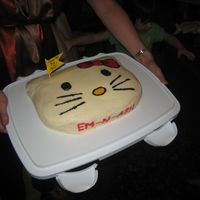 "Hello Kitty yellow cake frosted in buttercream. 1st time using ""Viva"" paper towel method. And also ""painting"" on the the frosting...."