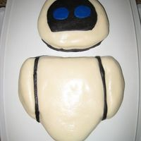 Eve  1st time working with fondant. Chocolate cake covered with buttercream and MMF. Couldn't figure out how to do the arms correctly. -...
