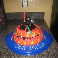 Darth On Fire Similar to on fire cake-tinted choc buttercream/fondant flames/Light sabers are actually molded out of clay.