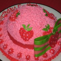 Strawberry Shortcake Hat 1st decorated cake ever. Yellow cake with strawberry filling and buttercream frosting. Bow and hat band are melted starbursts. TFL!