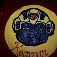 Kearnan's Bumblebee Transformer Cake   This is a BC cake with a FBCT Bumblebee transformer on it. It was inspired by knel's transformer cake.