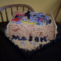 Mason's Tool Box Cake This was suppose to be a tool box cake inspired by Macsmom. Didn't turn out quite right, but it still was alright. Some of the tools...