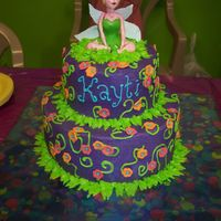 Kayti's Tinkerbell Birthday Cake  This tinkerbell cake was made for my niece's 9th birthday. It is orange cake with vanilla custard filling. Thanks to MacsMom for your...