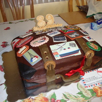 Luggage Cake My dad is a world traveler, so I made an old fashioned suitcase with travel stickers. The cake is covered with just chocolate frosting and...