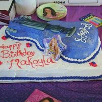 Hannah Montana Guitar Cake My first cake and I hope to get better : ) The cake was WASC, minus the almond, buttercream frosting with fondant accents. I am going to...