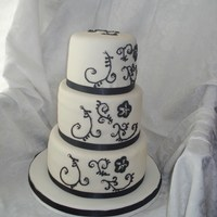"Black And White Scroll 6"", 8"", 10"" WASC with IMBC and fondant overlay. Black scroll with silver dragees and real satin black ribbon. TFL!"