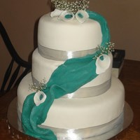 Teal And Silver Wedding Cake I made the calla lilies to match the teal fondant swag. Wasn't sure how this was going to look but I think the bride will like it. All...