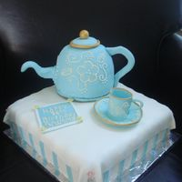 Teapot Cake I made this for an 86 year old lady's birthday. The teapot is chocolate with strawberry cream filling and fondant and gumpaste decor....