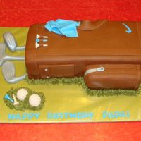 Golfbag Cake  I did this cake for my dad. I didn't like the wilton golf bag pan so I used a 11x15 and carved it. Everything is fondant, except tfot...