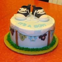 Clothesline Baby Shower Cake  This is my first clothes line cake, I did it for a friend. The mom wanted some black in it. thanks for lookingcake is covered in...