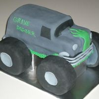 Grave Digger Birthday Cake I had a ton of fun making this one, I actually got this customer from a referral from the Dr.Seuss cake the week before. The tires are made...