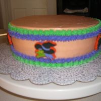 Birthday Cake This is a Birthday cake. I found Halloween lollipop of weird figures and I stick on top off it. Everyone love the cake.