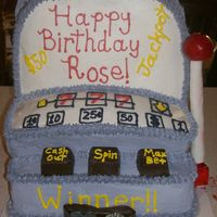 Slot Machine   shaped cake then icing is butter cream used some choc melted and shaped also used some fondant
