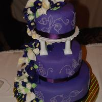 Dark Purple Wedding Cake  This is my second wedding cake, much less stressful than the first. It's vanilla cake with chocolate meringue buttercreme filling. The...
