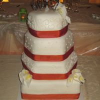 Img_9160.jpg  My first wedding cake! It's lemon cake with lemon curd, covered in lemon buttercreme and fondant. The ribbon on the cake matched the...