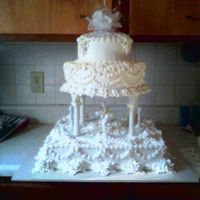 "Dancing Cherubs This cake is a 16"" square with a 12"" and and 8"" tier on top. This cake serves approximately 200. It was done with..."
