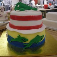 Dr. Suess Cake Its hard to see all the details in one picture, but 1st tier is one, two fish.... 2nd is cat in the hat and topper is green eggs and ham.