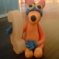 Swiper The Fox. I made this out of Fondant for my Sons 2nd birhtday. He's stealing/holding the #2 candle.