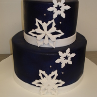 Snowflake Centerpiece Cakes   Centerpiece cakes for winter wedding with gumpaste snowflakes accents.