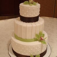 Lime And Brown Round Wedding Cake   Tiered Lime and Chocolate Brown Wedding Cake with Orchid accents to match centerpiece cakes
