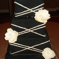 Black And Champagne Magnolia Cake 3 Tiered Black and Champagne Wedding Cake with Magnolia Accents