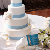 Calla Wedding Cake   Round Tiered Fondant Wedding Cake with gumpaste accents and cornflower blue ribbon
