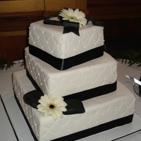 Black And White Gerbera Cake Fondant Quilted Cake with Gumpaste Bows and Black Eyed Gerbera Daisies