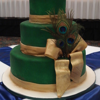 Peacock Cake   3 Tiered Round Wedding Cake with gold Fondant Bow and peacock feathers