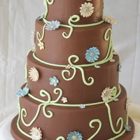 Chocolate Celebration Chocolate fondant with gumpaste daisies and vines. Major lesson learned from this one, don't agree to make a cake when you're...