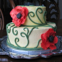 Poppies Two tier yellow buttercream cake with gumpaste poppies and fontant vines. Thanks for looking!