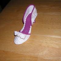 Wedding Shoe I made this shoe out of gum paste and fondant. I used the Wilton flower impression matThank you for looking